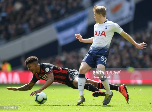 Juninho Bacuna of Huddersfield Town is tackled by Oliver Skipp of Tottenham Hotspur during the Premier League match between Tottenham Hotspur and...