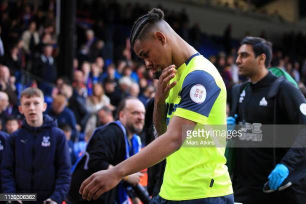Juninho Bacuna of Huddersfield Town looks dejected as he leaves the pitch following a loss which results in Huddersfield Town's relegation following...