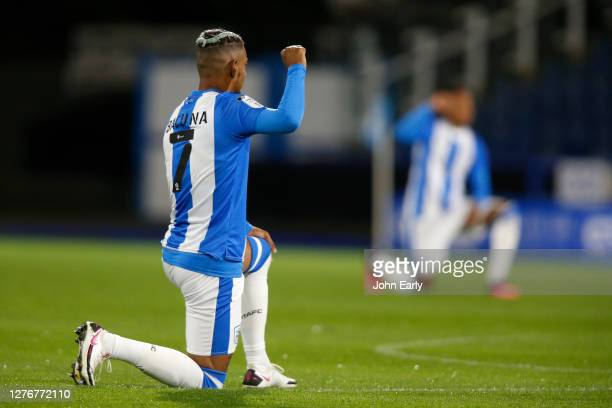 Juninho Bacuna of Huddersfield Town takes the knee during the Sky Bet Championship match between Huddersfield Town and Nottingham Forest at John...