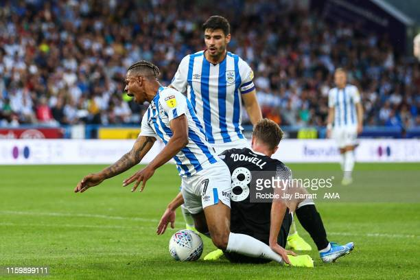 Juninho Bacuna of Huddersfield Town wins a penalty under a tackle from Kieran Dowell of Derby Count during the Sky Bet Championship match between...