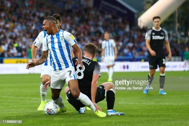 Juninho Bacuna of Huddersfield Town wins a penalty under a tackle from Kieran Dowell of Derby County during the Sky Bet Championship match between...