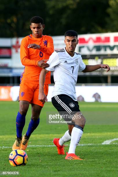 Juninho Bacuna of the Netherlands challenges Aymen Barkok of Germany during the International friendly match between U20 Netherlands and U20 Germany...