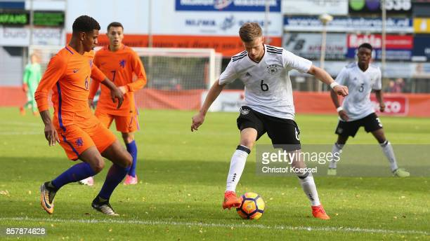 juninho Bacuna of the Netherlands challenges Dzenis Burnic of Germany during the International friendly match between U20 Netherlands and U20 Germany...