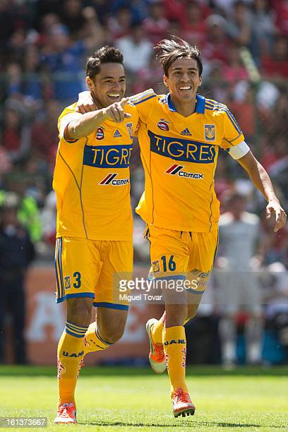 Juninho celebrates after scoring with teammates during a match between Toluca and Tigres as part of the Clausura 2013 at Nemesio Diez Stadium on...