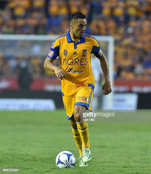Juninho drives the ball during a 9th round match between Tigres UANL and Monterrey as part of the Apertura 2015 Liga MX at Universitario Stadium on...