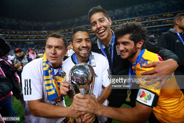 Juninho Javier Aquino and Damon Alvarez of Tigres celebrate with the trophy after winning the second leg of the Torneo Apertura 2017 Liga MX final...