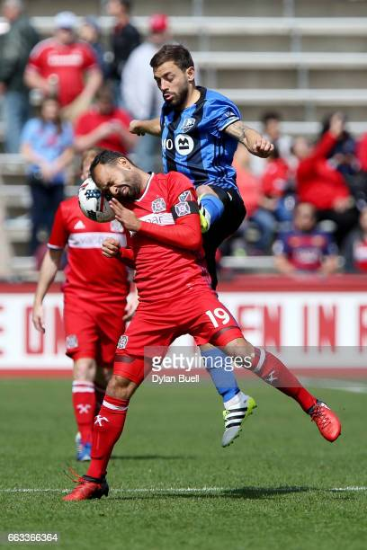 Juninho of Chicago Fire and Hernan Bernardello of Montreal Impact battle for the ball in the first half during an MLS match at Toyota Park on April 1...