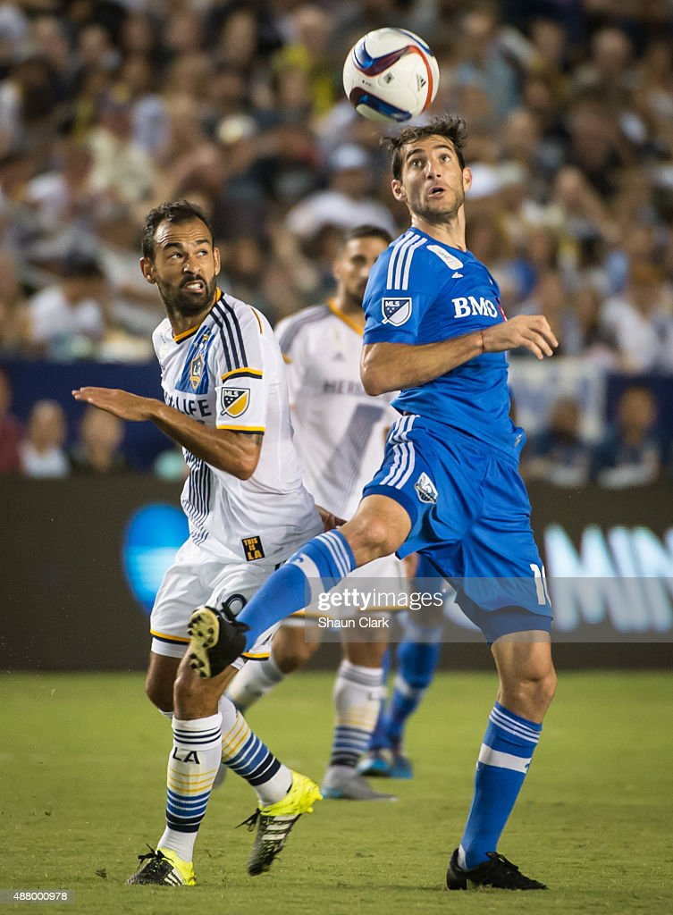 Juninho #19 of Los Angeles Galaxy battles Ignacio Piatti #10 of Montreal Impact during Los Angeles Galaxy's MLS match against Montreal Impact at the StubHub Center on September 12, 2015 in Carson, California. The match ended in 0-0 tie