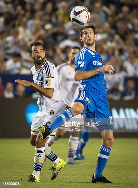 Juninho of Los Angeles Galaxy battles Ignacio Piatti of Montreal Impact during Los Angeles Galaxy's MLS match against Montreal Impact at the StubHub...