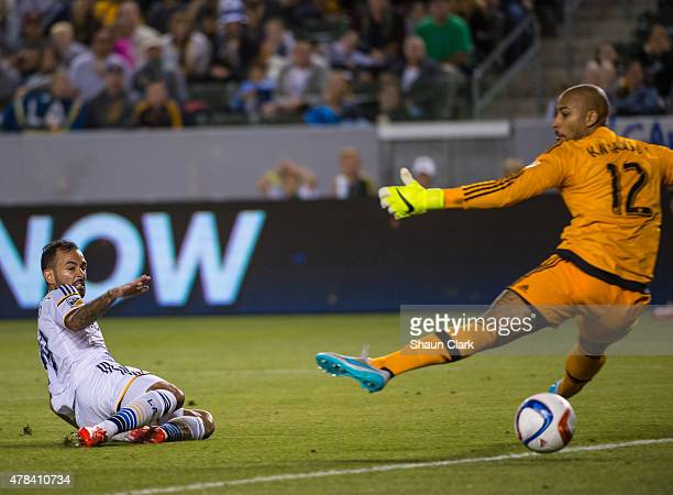 Juninho of Los Angeles Galaxy scores a goal as Adam Kwarasey of Portland Timbers tries to make a save during Los Angeles Galaxy's MLS match against...