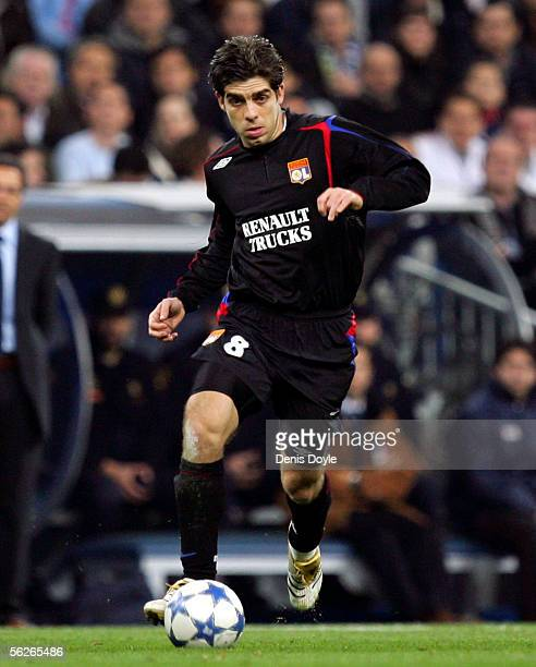 Juninho of Lyon dribbles the ball during the UEFA Champions League group F match between Real Madrid and Olympique Lyon at the Bernabeu stadium on...