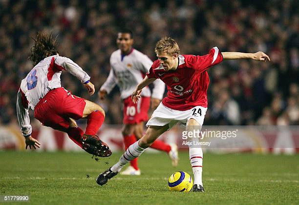 Juninho of Lyon lunges in on Darren Fletcher of Manchester United during the UEFA Champions League Group D match between Manchester United and...