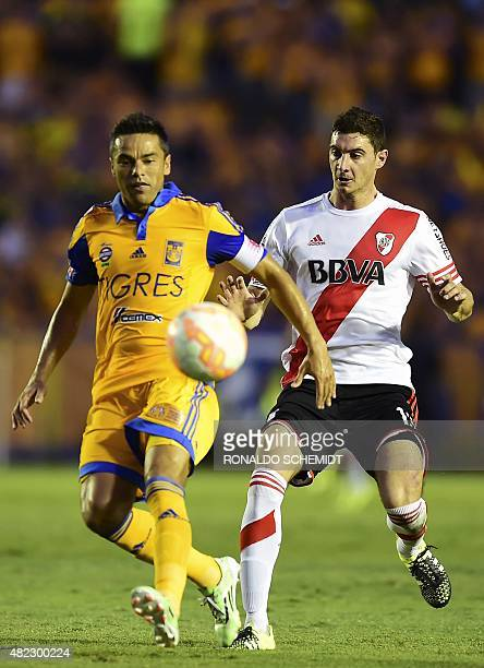 Juninho of Mexico's Tigres vies for the ball with Lucas Alario of Argentina's River Plate during their Libertadores Cup first leg final at the...