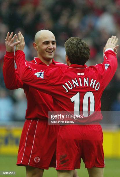 Juninho of Middlesbrough celebrates scoring the equalising goal with teammate Massimo Maccarone during the FA Barclaycard Premiership match between...