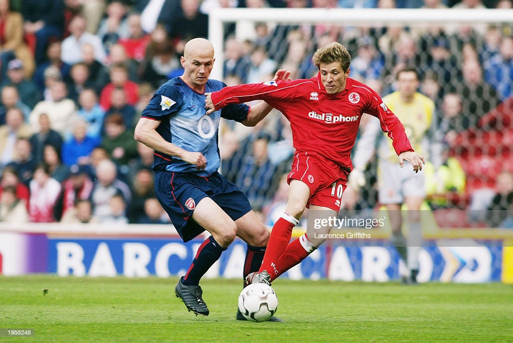 Juninho of Middlesbrough skips past Pascal Cygan of Arsenal during the FA Barclaycard Premiership match between Middlesbrough and Arsenal held on April 19, 2003 at The Riverside Stadium in Middlesbrough, England. Arsenal won the match 2-0.