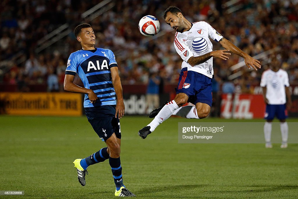 Juninho #9 of MLS All-Stars heads the ball away from Dele Alli #20 of Tottenham Hotspur during the 2015 AT&T Major League Soccer All-Star game at Dick's Sporting Goods Park on July 29, 2015 in Commerce City, Colorado.