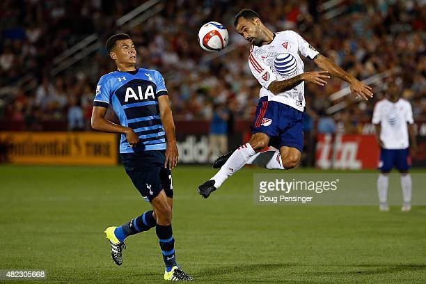 Juninho of MLS All-Stars heads the ball away from Dele Alli of Tottenham Hotspur during the 2015 AT&T Major League Soccer All-Star game at Dick's...