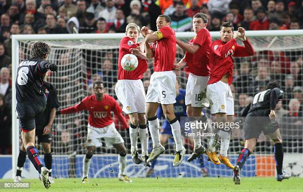 Juninho of Olympique Lyonnais takes a freekick during the UEFA Champions League first knockout round match between Manchester United and Olympique...