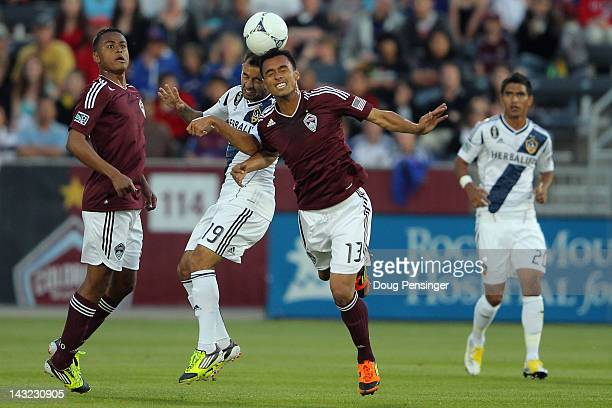 Juninho of the Los Angeles Galaxy and Kamani Hill of the Colorado Rapids battle for a head ball at Dick's Sporting Goods Park on April 21 2012 in...