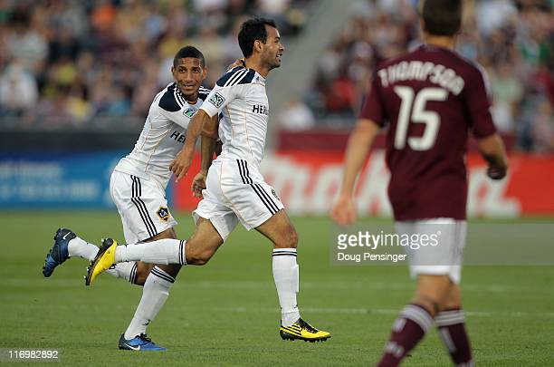 Juninho of the Los Angeles Galaxy celebrates his goal in the 42nd minute with teammate Sean Franklin of the Galaxy as Wells Thompson of the Colorado...
