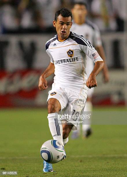 Juninho of the Los Angeles Galaxy passes the ball on the attack in the second half during their MLS match against the New England Revolution at the...