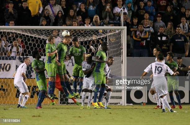 Juninho of the Los Angeles Galaxy scores on a direct free kick over the Seattle Sounders defensive wall in th first half of their MLS match at...