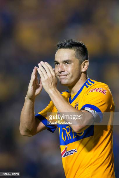 Juninho of Tigres celebrates after scoring his team's winning goal via penalty during the 12th round match between Tigres UANL and Chivas as part of...