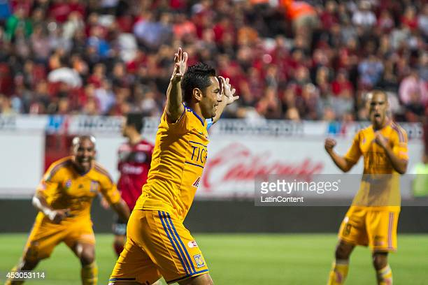 Juninho of Tigres celebrates after scoring the tying goal during a match between Tijuana and Tigres UANL as part of 3rd round Apertura 2014 Liga MX...