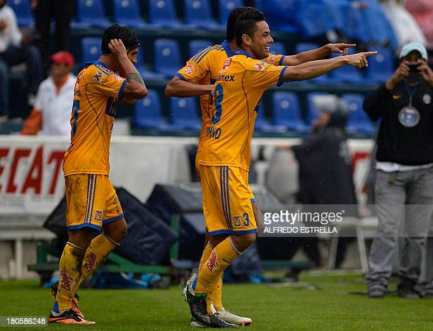 Juninho of Tigres celebrates his goal against Cruz Azul with his teammates Alan Pulido and Hugo Ayala during their Mexican Soccer Clausura 2013...