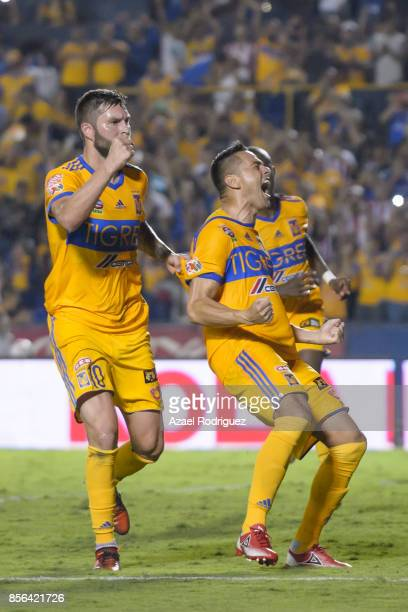 Juninho of Tigres celebrates with teammate Andre Gignac after scoring his team's winning goal via penalty during the 12th round match between Tigres...