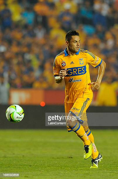 Juninho of Tigres conduces the ball during a match between Tigres and Monterrey as part of the Play offs of the Torneo Clausura 2013 on May 11 2013...