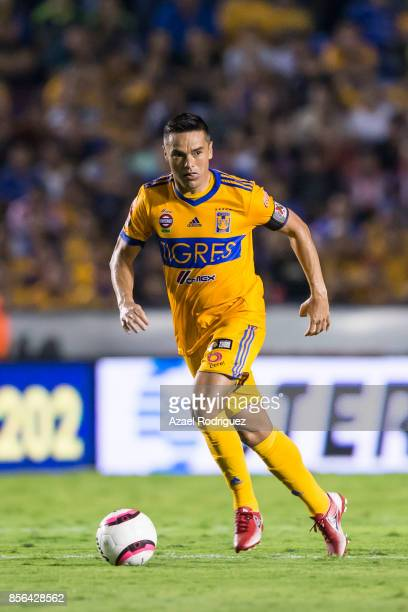 Juninho of Tigres drives the ball during the 12th round match between Tigres UANL and Chivas as part of the Torneo Apertura 2017 Liga MX at...