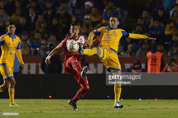 Juninho of Tigres fights for the ball with Fernando Uribe of Toluca during the semifinals first leg match between Tigres UANL and Toluca as part of...