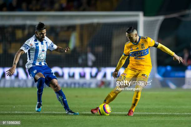 Juninho of Tigres fights for the ball with Franco Jara of Pachuca during the 4th round match between Tigres UANL and Pachuca as part of the Torneo...