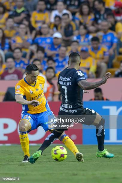 Juninho of Tigres fights for the ball with Javier Cortes of Pumas during the 14th round match between Tigres UANL and Pumas UNAM as part of the...