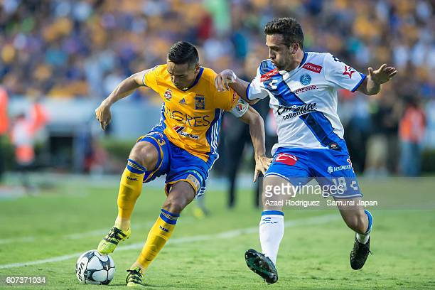 Juninho of Tigres fights for the ball with Jeronimo Amione of Puebla during the 10th round match between Tigres UANL and Puebla as part of Torneo...