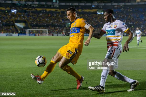 Juninho of Tigres fights for the ball with Keyner Brown of Herediano during the second leg match between Tigres UANL and Herediano as part of round...