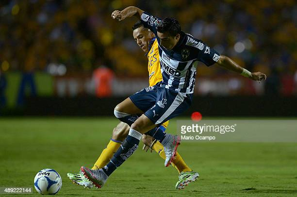 Juninho of Tigres fights for the ball with Rogelio Funes Mori of Monterrey during a 9th round match between Tigres UANL and Monterrey as part of the...