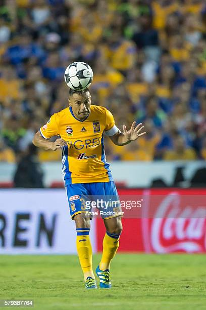 Juninho of Tigres heads the ball during the 2nd round match between Tigres UANL and Atlas as part of the Torneo Apertura 2016 Liga MX at...
