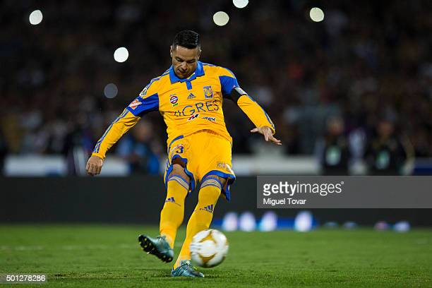 Juninho of Tigres kicks the second penalty kick during the final second leg match between Pumas UNAM and Tigres UANL as part of the Apertura 2015...