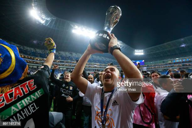 Juninho of Tigres lifts the trophy to celebrate after winning the second leg of the Torneo Apertura 2017 Liga MX final between Monterrey and Tigres...