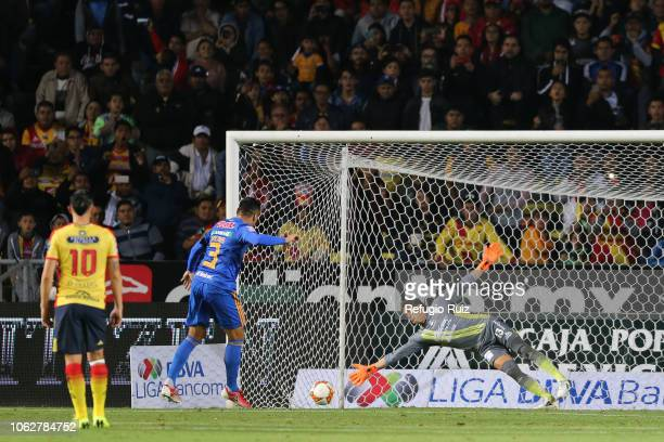 Juninho of Tigres scores the first goal of his team during the 15th round match between Morelia and Tigres UANL as part of the Torneo Apertura 2018...
