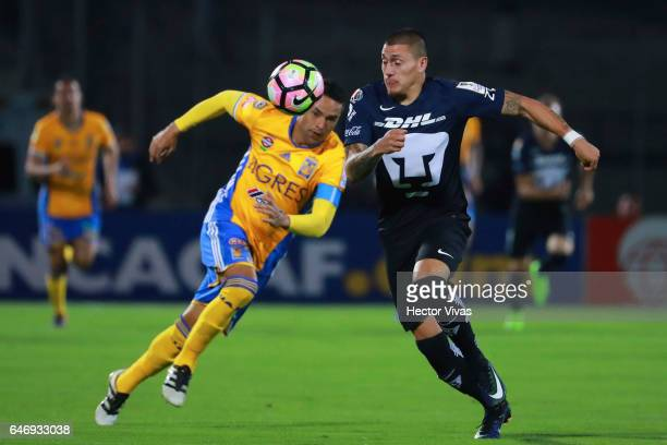 Juninho of Tigres struggles for the ball with Nicolas Castillo of Pumas during the quarterfinals second leg match between Pumas UNAM and Tigres UANL...
