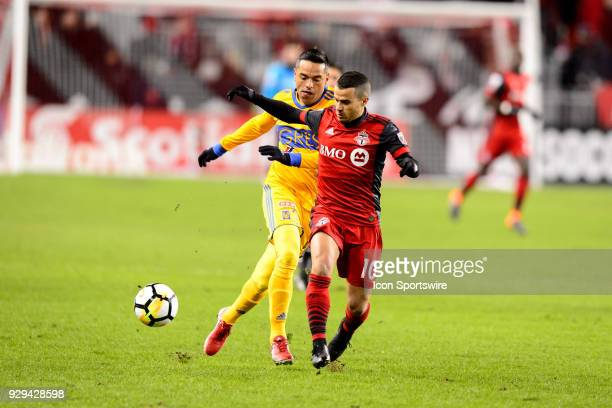 Juninho of Tigres UANL attempts to stop Sebastian Giovinco of Toronto FC during the first half of the CONCACAF Champions League Quarterfinal match...