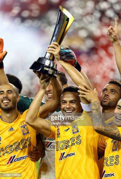 Juninho of Tigres UANL lifts the 2018 Campeones Cup Final trophy after victory against Toronto FC at BMO Field on September 19 2018 in Toronto Canada