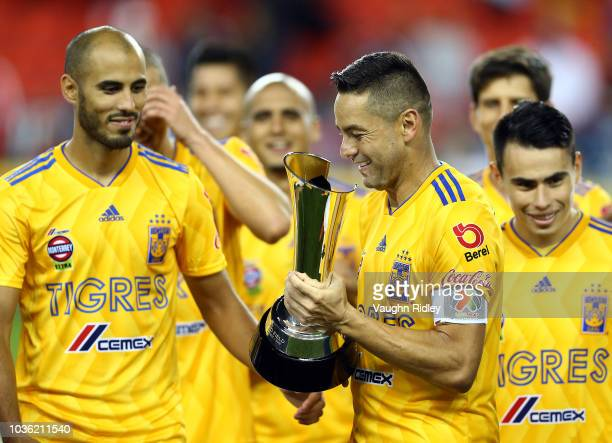 Juninho of Tigres UANL prepares to lift the 2018 Campeones Cup Final trophy after victory against Toronto FC at BMO Field on September 19 2018 in...