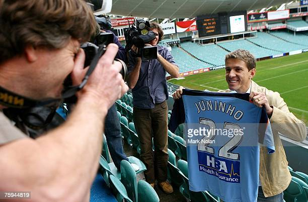 Juninho Paulista poses for photos during the press conference to announce the signing of Juninho Paulista with Sydney FC at Aussie Stadium on August...