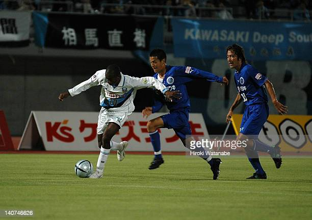 Juninho whose real name is Carlos Alberto Carvalho Dos Anjos Junior of Kawasaki Frontale and Shohei Ogura of Mito Hollyhock compete for the ball...