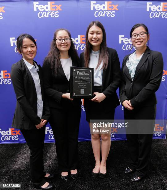 Junior Achievement of Southeast Texas students from Klein Collins High School accept the FedEx Junior Business Challenge qualifying award at the...