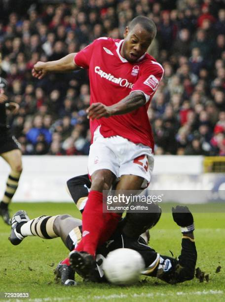 Junior Agogo of Nottingham Forest gets his shot in ahead of Souleyman Diawara of Charlton Athletic to open the scoring during the the FA Cup...